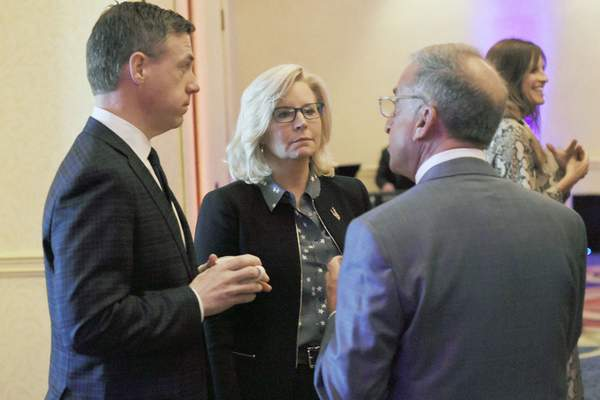 Rachel Von   The Journal Gazette  Republican U.S. Rep.Liz Cheney of Wyoming talks withRep. Jim Banks, R-3rd, left, and Steve Shine during a meet-and-greet VIP reception before the start of the Lincoln Day Dinner at the Ramada Plaza Hotel and Conference Center on Friday.