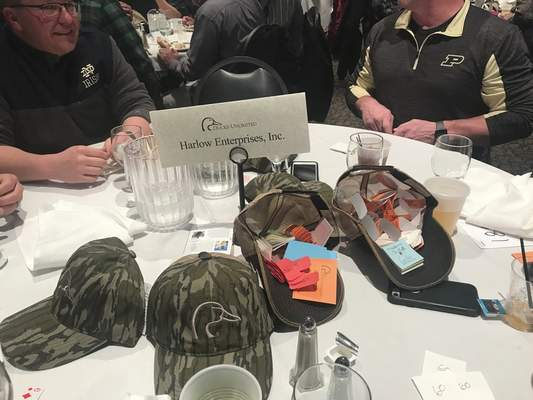 Jamie Duffy | The Journal Gazette  Raffle tickets are stashed in Ducks Unlimited caps at the April 19 Fort Wayne Ducks Unlimited Gun Bash.