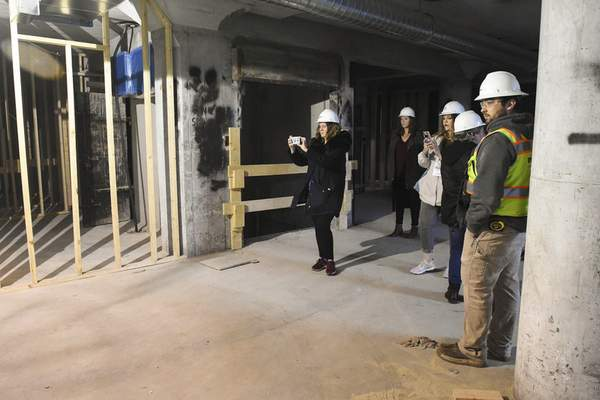 Michelle Davies   The Journal Gazette Visit Fort Wayne hosted a group of travel writers, showing them areas of attraction in downtown Fort Wayne, including the progress on Promenade Park. Dominic Bonavita, with Model Construction, took the visitors for a tour of various building on The Landing iincluding Flashbacks.