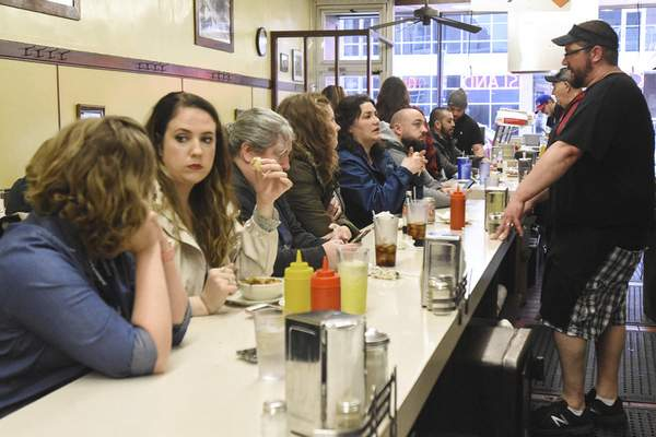 Michelle Davies   The Journal Gazette During their visit to the city last month, travel writers ate lunch at Fort Wayne's Famous Coney Island. Restaurants are a big part of guided tours of the city, the experts say.
