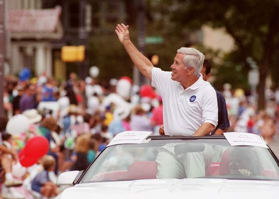 File  Sen. Richard Lugar, R-Ind.,rides in the Three Rivers Festival Parade in downtown Fort Wayne in 1999.