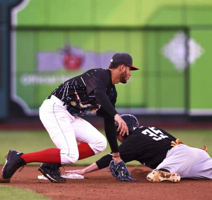 Katie Fyfe | The Journal Gazette  TinCaps' Justin Lopez goes to tag Quad Cities River Bandit's Austin Dennis at second base during the fourth inning at Parkview Field on Saturday.