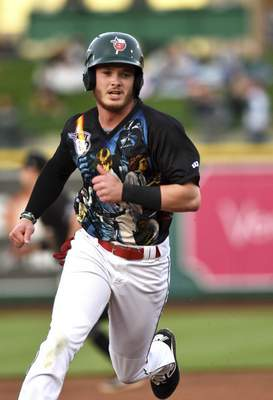 Katie Fyfe | The Journal Gazette  TinCaps' Grant Little runs from second base to home base during the second inning against the Quad Cities River Bandits at Parkview Field on Saturday.