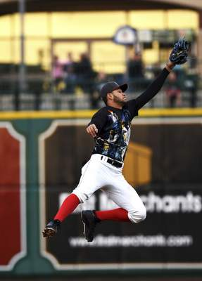 Katie Fyfe | The Journal Gazette  TinCaps' Justin Lopez jumps to catch the ball during the third inning against the Quad Cities River Bandits at Parkview Field on Saturday.