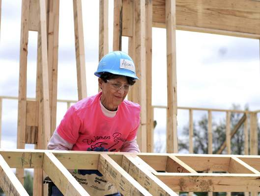 Katie Fyfe | The Journal Gazette  Alison Bauer with Trinity Episcopal Church volunteers for Humanity Women Build at Fuller's Landing on Saturday. This is Bauer's fifth year volunteering.