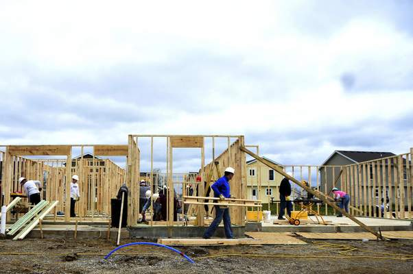 Katie Fyfe | The Journal Gazette  Habitat for Humanity Women Build works on building a home in Fuller's Landing on Saturday. More than 400 localwomen will work together over the month of May to complete the home for a future deserving homeowner.