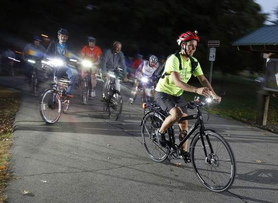 Amy Hartzog, a cycling instructor with the League of American Bicyclists and bike commuter, teaches bicyclists how to ride and safety tips.
