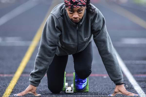 Mike Moore | The Journal Gazette  Northrop's Jo'Deci Irby has her game face on before the start of a sprint during practice at Northrop High School on Tuesday.
