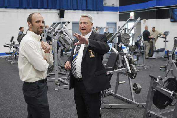 Mike Moore | The Journal Gazette  Sheriff David Gladieux, right, shows off the new Sheriff's Department Training and Fitness Center to City Councilman Joel Benz during the grand opening of the facility on Venture Lane on Thursday.
