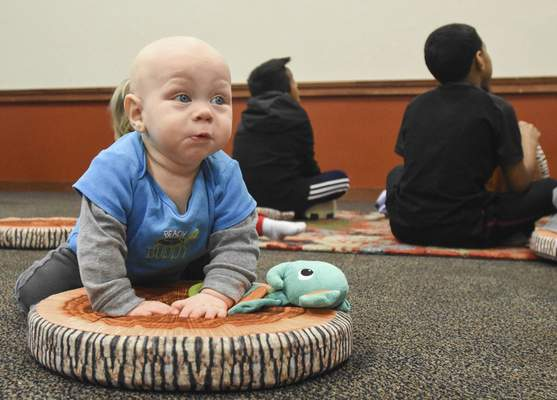 Michelle Davies | The Journal Gazette  Sam Meyer, 8 months, of Fort Wayne takes a spin on a