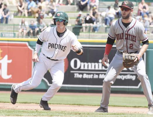 Rachel Von | The Journal Gazette  River Bandits' David Hensley keeps a close eye on the TinCaps' Blake Hunt as he leads off from first during the second inning at Parkview Field on Sunday.
