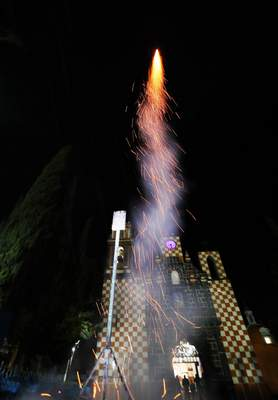 In this Thursday, May 2, 2019 photo, a fireworks shoots past during celebrations marking the Day of the Holy Cross that mixes Catholic traditions with pre-Hispanic rituals and beliefs, in the village Santiago Xalitzintla, Mexico. (AP Photo/Marco Ugarte)