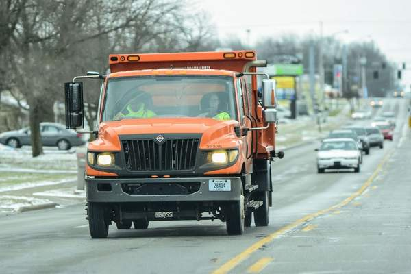 FILE: A salt truck drives north on Maplecrest Road following light snow in January.