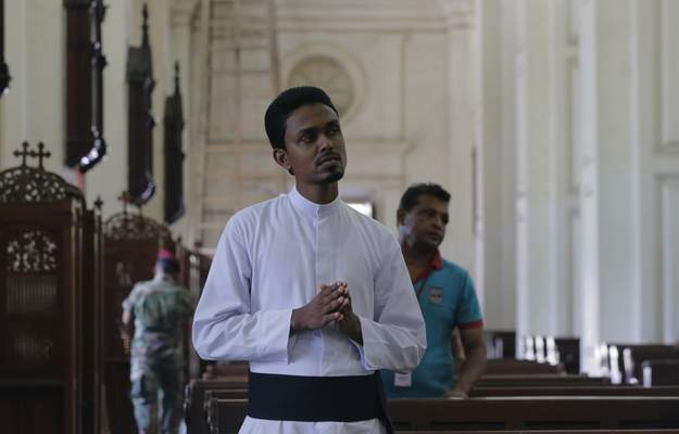 A Sri Lankan roman catholic priest prays at the St. Lucia's Cathedral during a holy mass held to bless victims of Easter Sunday attacks in Colombo, Sri Lanka, Saturday, May 11, 2019. More than 250 people were killed when suicide bombers struck three churches and three tourist hotels on Easter. Masses at churches were canceled for a second week last Sunday and the reopening of schools was postponed after reports warned of possible new attacks. (AP Photo/Eranga Jayawardena)