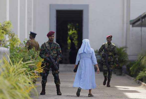 Sri Lankan army commando soldiers secure the St. Lucia's Cathedral during a holy mass held to bless the victims of Easter Sunday attacks in Colombo, Sri Lanka, Saturday, May 11, 2019. In the two Sundays that followed Easter, most churches were closed with armed guards. (AP Photo/Eranga Jayawardena)