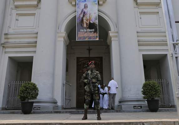 A Sri Lankan army commando soldier stands guard at the St. Lucia's Cathedral during a holy mass held to bless the victims of Easter Sunday attacks in Colombo, Sri Lanka, Saturday, May 11, 2019. More than 250 people were killed when suicide bombers struck three churches and three tourist hotels on Easter. Masses at churches were canceled for a second week last Sunday and the reopening of schools was postponed after reports warned of possible new attacks. (AP Photo/Eranga Jayawardena)