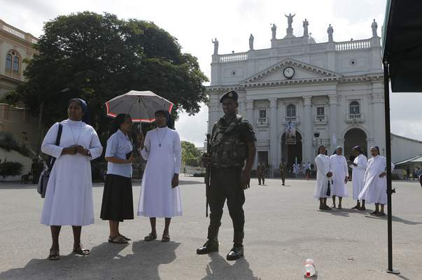 Sri Lankan army soldier secure the St. Lucia's cathedral as Catholic nuns attend a holy mass held to bless victims of Easter Sunday attacks in Colombo, Sri Lanka, Saturday, May 11, 2019. More than 250 people were killed when suicide bombers struck three churches and three tourist hotels on Easter. Masses at churches were canceled for a second week last Sunday and the reopening of schools was postponed after reports warned of possible new attacks. (AP Photo/Eranga Jayawardena)
