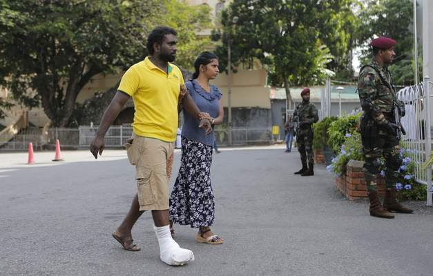 A survivor of the Easter Sunday attack arrives to attend a holy mass held to bless the victims of the attacks in Colombo, Sri Lanka, Saturday, May 11, 2019. More than 250 people were killed when suicide bombers struck three churches and three tourist hotels on Easter. Masses at churches were canceled for a second week last Sunday and the reopening of schools was postponed after reports warned of possible new attacks. (AP Photo/Eranga Jayawardena)
