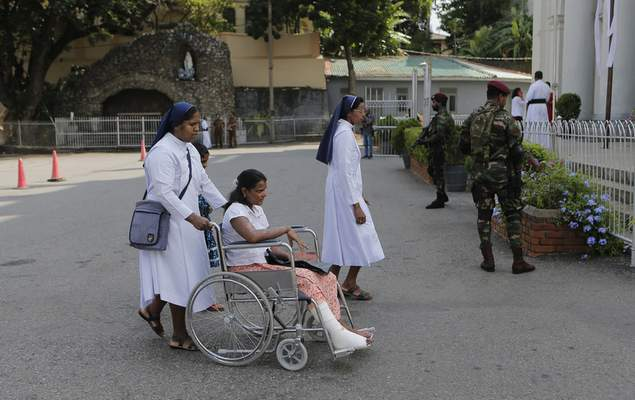 Sri Lankan Catholic nuns push a wheelchair carrying a survivor of the Easter Sunday attack for a holy mass held to bless the victims of the attacks in Colombo, Sri Lanka, Saturday, May 11, 2019. More than 250 people were killed when suicide bombers struck three churches and three tourist hotels on Easter. Masses at churches were canceled for a second week last Sunday and the reopening of schools was postponed after reports warned of possible new attacks. (AP Photo/Eranga Jayawardena)