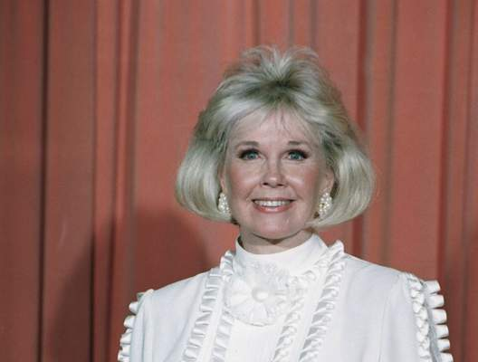Associated Press: In this Jan. 28, 1989 file photo, actress and animal rights activist Doris Day poses after receiving the Cecil B. DeMille Award at the annual Golden Globe Awards ceremony in Los Angeles. Day has died at age 97.