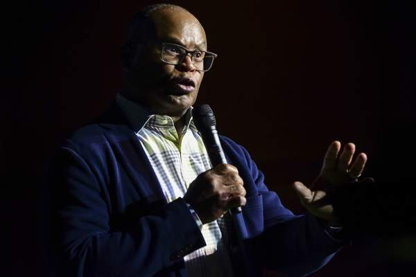 Mike Moore | The Journal Gazette Former Chicago Bears linebacker Mike Singletary speaks during the Fellowship of Christian Athletes Night of Hope at Memorial Coliseum on Monday night.