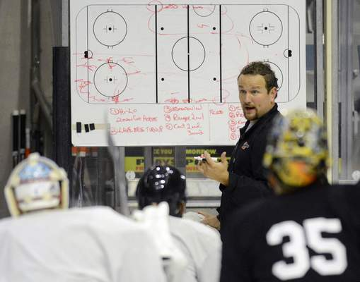 Gary Graham, the fourth-winningest coach in Komets history, draws up a play at practice. He was fired Monday. (File photo)
