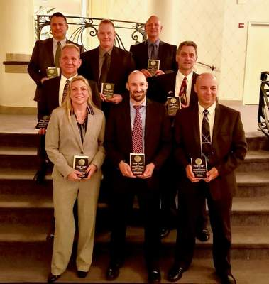 Local Top Cop recipients are, back row, from left:  Cpl.  Sean Kelly,  Officer Darren Compton,  Allen County Sheriff's Department; Detective Brian Martin,  Fort Wayne Police. Middle row:  Officer Tim Loe,  sheriff's department; Detective Kevin Smith,  Indiana State Police. Front row:  Kerri L. Reifel,  Jeffrey Robertson,  FBI;  Detective Clint Hetrick,  state police. FWPD Detective Cary Young is not pictured. (Courtesy)