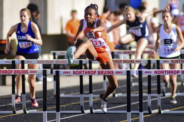 Mike Moore | The Journal Gazette Northrop freshman Morgan Patterson competes in the 100-meter hurdles Tuesday during the IHSAA girls track and field sectionals at Northrop High School. Patterson finished second in 15.07 seconds.