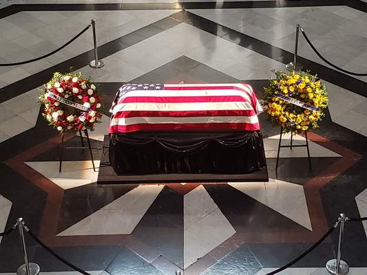Former U.S. Sen. Richard Lugar's casket sits in the Statehouse rotunda Tuesday. Lugar's funeral is today. (Niki Kelly | The Journal Gazette)