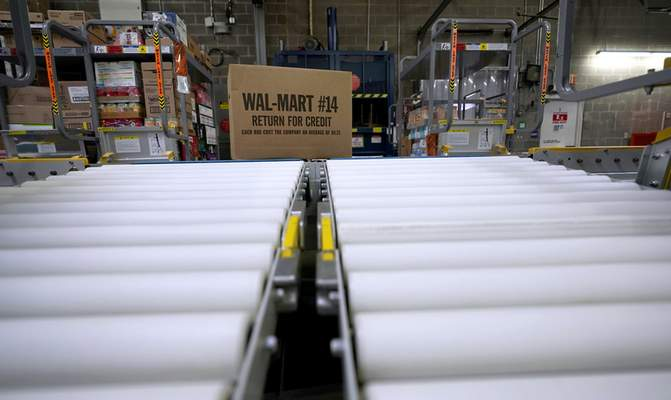 Associated Press Walmart is rolling out free next-day delivery on its most popular items. The nation's largest retailer said Tuesday it's been building a network of more efficient e-commerce distribution centers to make that happen.