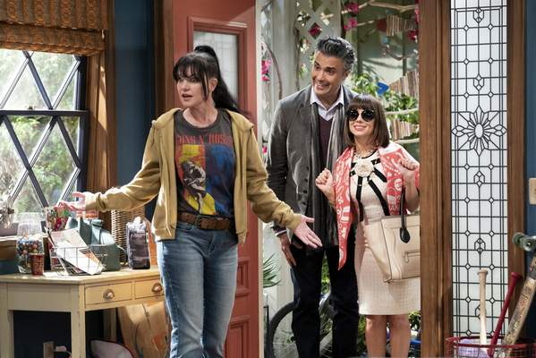 This image released by CBS shows, from left, Pauley Perrette, Jaime Camil and Natasha Leggero in a scene from the sitcom Broke. (Sonja Flemming/CBS via AP)