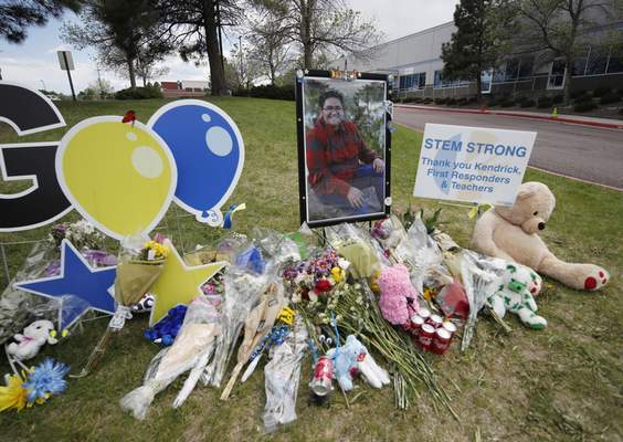 A display grows outside the STEM School Highlands Ranch a week after the attack on the school that left one student dead and others injured, Tuesday, May 14, 2019, in Highlands Ranch, Colo. Student Kendrick Castillo pictured in the display was was fatally wounded in the May 7 shooting. (AP Photo/David Zalubowski)