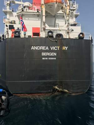 This photo provided by the United Arab Emirates' National Media Council shows the Norwegian-flagged oil tanker MT Andrea Victory off the coast of Fujairah, United Arab Emirates, Monday, May 13, 2019. Two Saudi oil tankers and a Norwegian-flagged vessel were damaged in what Gulf officials described Monday as a