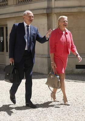 IBM CEO Virginia Rometty, right, and French cosmetics giant L'Oreal CEO Jean-Paul Agon arrive for the Tech for Good summit, Wednesday, May 15, 2019 in Paris. World leaders and tech bosses meet Wednesday in Paris to discuss ways to prevent social media from spreading deadly ideas. (AP Photo/Thibault Camus)