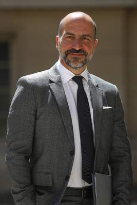 Uber CEO Dara Khosrowshahi poses as he arrives for the Tech for Good summit in Paris, Wednesday, May 15, 2019 in Paris. World leaders and tech bosses meet Wednesday in Paris to discuss ways to prevent social media from spreading deadly ideas. (AP Photo/Thibault Camus)