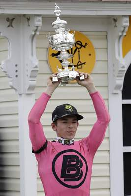 Tyler Gaffalione holds the Woodlawn Vase after riding War of Will to victory at the Preakness.