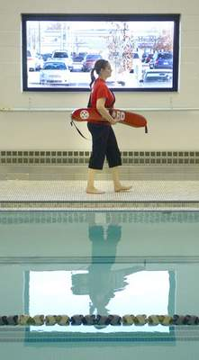 Courtesy  The YMCA's lifeguard training program is Red Cross certified and teaches lifeguards proper rescue techniques. This includes how to help someone with a severe head, neck or spinal injury, and how to properly investigate the three levels of water.