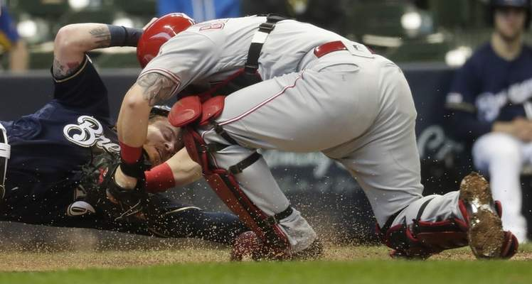 Cincinnati Reds catcher Tucker Barnhart tags out Milwaukee Brewers' Ben Gamel at home during the second inning of a baseball game Wednesday, May 22, 2019, in Milwaukee. (AP Photo/Morry Gash)