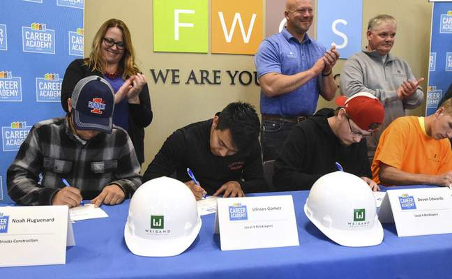 Students with Fort Wayne Community Schools' Anthis Career Center sign letters of intent with area employers Wednesday afternoon at the Family & Community Engagement Center. (Photos by Michelle Davies | The Journal Gazette)
