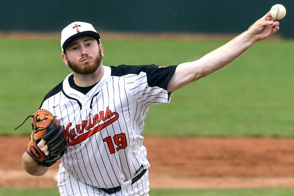 Pete Caster | For The Journal Gazette  Indiana Tech starter Charles Dunavan delivers a pitch to a Bellevue batter during the top of the fourth inning of Game 1 of the NAIA World Series on Friday at Harris Field in Lewiston, Idaho.