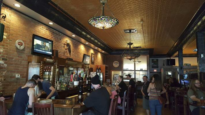 Tiffany chandeliers hang over the antique bar at Welch's Ale House on South Calhoun St.