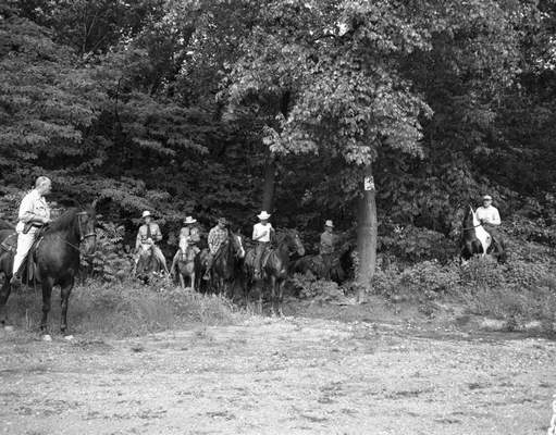 """File  Lt. Charles Morrow, left, directs some of the Sheriff's Mounted Posse in the snake hunt June 14, 1952. The men were part of a hunting party that numbered about 100 people searching for """"Pete the Python."""""""