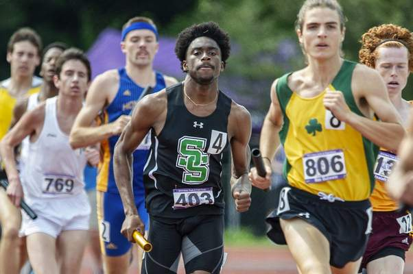 Photos by Chad Williams | Special to The Journal Gazette Kaiden Long, shown here in the 3,200-meter relay, was also part of South Side's state champion 1,600-meter relay  in Bloomington on Friday. 2 decks please
