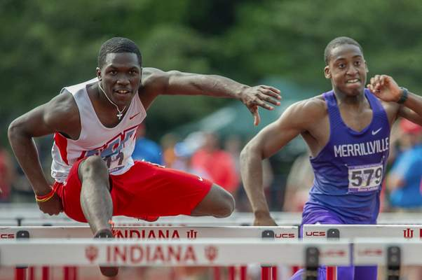 Chad Williams | The Journal Gazette  Ronald Elliot of Wayne in the 110-meter hurdles at state track in Bloomington.