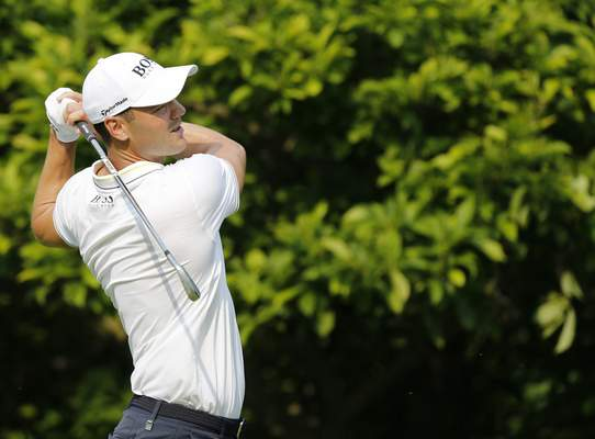 Associated Press Co-leader Martin Kaymer tees off on the eighth hole during the second round of the Memorial on Friday in Dublin, Ohio.