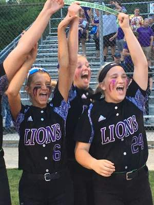 Leo seniors, including Madison Dekoninck (6) and Mackenzie Rust (24) hoist the semistate championship plaque after beating Crown Point 11-1 at Harrison. (Dylan Sinn)