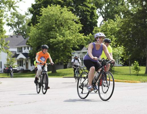 Katie Fyfe   The Journal Gazette  Cyclists make their way through local neighborhoods during Saturday's  Fort4Fitness Spring Cycle.