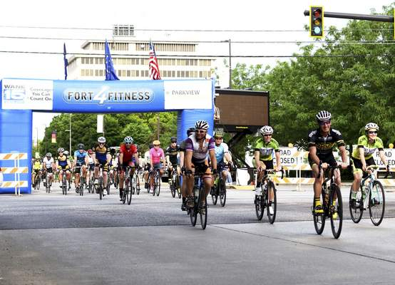 Photos by Katie Fyfe   The Journal Gazette Riders begin the eighth annual Fort4Fitness Spring Cycle on East Main Street on Saturday morning.