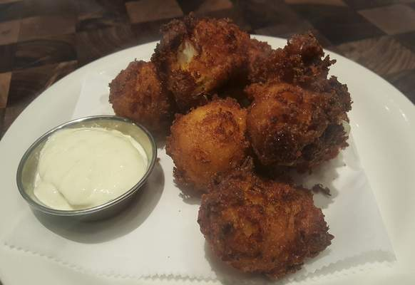 Lumb crab hushpuppies from Conner's Kitchen + Bar in the Courtyard by Marriott downtown.