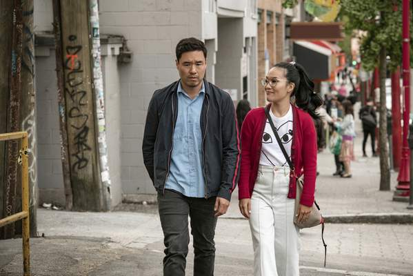 This undated image shows Randall Park and Ali Wong in a scene from the movie Always Be My Maybe. The newly released Netflix movie is an Asian-American rom-com with a twist: ethnicity isn't central to the plot. (Courtesy of Netflix)